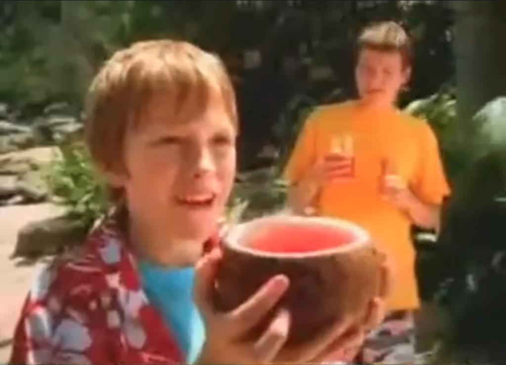 Still from Kool Aid SUS TV Commerical (2006) - A Boy Drinks Kool Aid from a Coconut